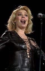 Kim Wilde steps out of the her TV Gardening clothes and Back on Stage to Tour with<br /><br />Steve Starnge (Visage)<br />Claire Grogan (Altered Images)<br />The Belle Stars<br />Dollar<br />The Human League<br />Play on the Here and Now  Christmas Party Tour at Sheffields Hallam FM Arena Friday 13th December 2002<br /><br />[#Beginning of Shooting Data Section]<br />Nikon D1 <br />2002/12/13 22:25:32.2<br />JPEG (8-bit) Fine<br />Image Size:  2000 x 1312<br />Color<br />Lens: 80-200mm f/2.8-2.8<br />Focal Length: 80mm<br />Exposure Mode: Manual<br />Metering Mode: Spot<br />1/200 sec - f/2.8<br />Exposure Comp.: 0 EV<br />Sensitivity: ISO 800<br />White Balance: Auto<br />AF Mode: AF-S<br />Tone Comp: Normal<br />Flash Sync Mode: Not Attached<br />Color Mode: <br />Hue Adjustment: <br />Sharpening: Normal<br />Noise Reduction: <br />Image Comment: <br />[#End of Shooting Data Section]
