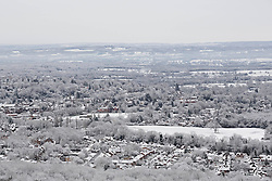© Licensed to London News Pictures. 17/01/2016. Woldingham, UK. The snow covered roofs of Oxted and the Surrey hills are seen from the top of the North Downs today (17/01/2016) after snow hit parts of the UK for the first time this winter. Photo credit: Matt Cetti-Roberts/LNP