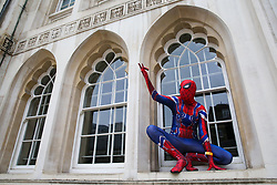 © Licensed to London News Pictures. 06/04/2019. London, UK. A person dressed in Spider-Man outfit climbs a building<br /> during London Games Festival Character Parade.  Photo credit: Dinendra Haria/LNP