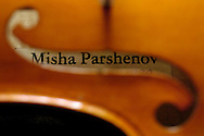 The mark of violin maker and restorer Misha Parshenov inside a violin he made from scratch.