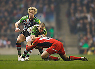 Picture by Andrew Tobin/Focus Images Ltd. 07710 761829. .27/12/11. Mike Brown (15) of Harlequins is tackled by Alex Goode (15) of Saracens (red) during the Aviva Premiership match between Harlequins and Saracens at Twickenham Stadium, London.