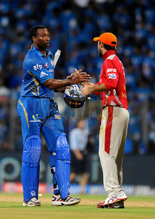 Kieron Pollard of the Mumbai Indians shake hands with Glenn Maxwell of the Kings X1 Punjab after winning match 22 of the Pepsi Indian Premier League Season 2014 between the Mumbai Indians and the Kings XI Punjab held at the Wankhede Cricket Stadium, Mumbai, India on the 3rd May  2014<br /> <br /> Photo by Pal Pillai / IPL / SPORTZPICS<br /> <br /> <br /> <br /> Image use subject to terms and conditions which can be found here:  http://sportzpics.photoshelter.com/gallery/Pepsi-IPL-Image-terms-and-conditions/G00004VW1IVJ.gB0/C0000TScjhBM6ikg