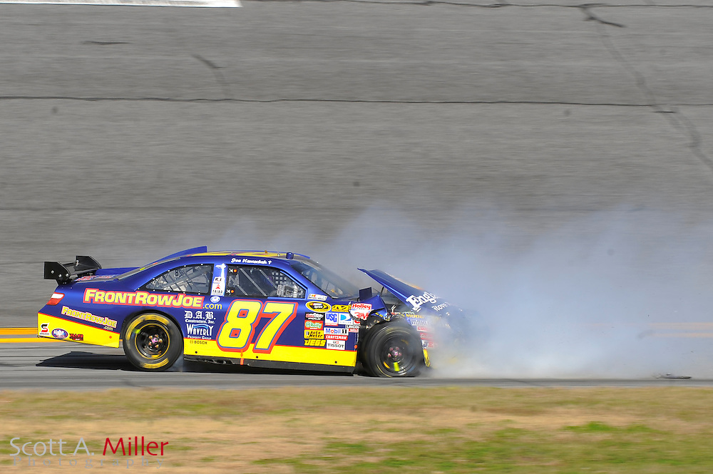Feb. 14, 2010; Daytona Beach, FL, USA; NASCAR Sprint Cup Series driver Joe Nemechek (87) spins out in Turn 4 during the Daytona 500 at Daytona International Speedway. ©2010 Scott A. Miller