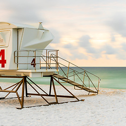 Pensacola Beach lifeguard tower four at the start of sunrise on Casino Beach. Pensacola Beach is on Santa Rosa Island in the Emerald Coast area of the Southeastern United States of America. Panorama photo ratio is 1:3. Copyright ⓒ 2018 Paul Velgos with All Rights Reserved.