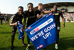 Free to use courtesy of Sky Bet - Cheyenne Dunkley and Gavin Massey of Wigan Athletic celebrate winning promotion to the Sky Bet Championship - Mandatory by-line: Robbie Stephenson/JMP - 21/04/2018 - FOOTBALL - Highbury Stadium - Fleetwood, England - Fleetwood Town v Wigan Athletic - Sky Bet League One