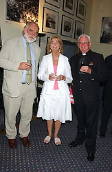 Left to right, Anne Widdecombe's editor and publisher ION TREWIN and CANON MALCOLM WIDDECOMBE and his wife MERYL at a party to celebrate the publication of 'An Act of Peace' by Ann Widdecombe at 11 Carlton House Terrace, London on 19th July 2005.<br />