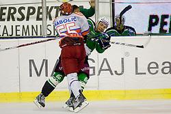 Robert Sabolic (HK Acroni Jesenice, #55) with big hit on Petr Sachl (HDD Tilia Olimpija, #19) during ice-hockey match between HD Tilia Olimpija and HK Acroni Jesenice  in 6th Round of EBEL league, on September 26, 2010 at Hala Tivoli, Ljubljana, Slovenia. (Photo By Matic Klansek Velej / Sportida.com)