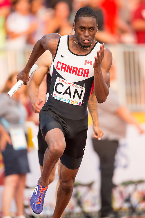 Brendan Rodney of Canada runs his leg of the men's 4X100 metre relay at the 2015 Pan American Games at CIBC Athletics Stadium in Toronto, Canada, July 25,  2015.  AFP PHOTO/GEOFF ROBINS
