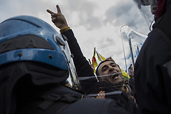 February 5, 2018 - Rome, Rome, Italy - Protesters seen shouting slogans during the demonstration..Hundred of demonstrators clashed with police near the Vatican during the Turkish president's visit to Rome, as protesters denounced Recep Tayyip Erdogan's presence amid Ankara's anti-Kurdish military campaign in Syria, at least one person injured. (Credit Image: © Danilo Campailla/SOPA via ZUMA Wire)