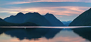Sunset at Alouette Lake on an early summer evening. Mountains in the background include Mount Nutt (left), Mount Gatey, Mount Clarke and Mount Ratney (back, right). Photographed on the beach at Alouette lake in Golden Ears Provincial Park - Maple Ridge, British Columbia, Canada.