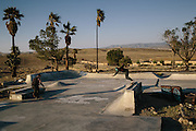 Rigoberto Vindiola, 32, right, and Christopher DeLeon, 20, skate at Kern Side, an little known skate park in the foothills outside of Bakersfield, California.