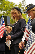 Merrick, New York, U.S. - May 26, 2014 - R-L, DEBRA BERNHARDT and MARGARET BIEGELMAN, members of the Merrick American Legion Auxiliary Post 1282, participate in The Merrick Memorial Day Parade and Ceremony. They bowed their heads during a Moment of Silence, for those who died in war while serving in the United States military.