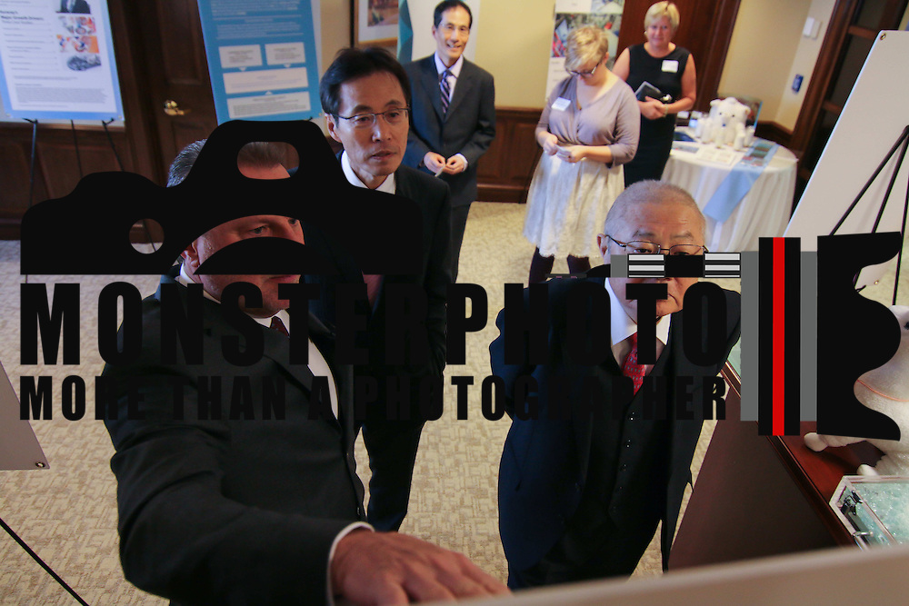 General Manager of GLS/Vinyls Stephen L. Cox (LEFT) Director and Primary Executive Officer Keiji Murakami (CENTER) and Kuraray President Fumio Ito seen reviewing photo boards during Kuraray welcome ceremony Tuesday, Nov 18, 2014 at Kuraray in Wilmington, Del.