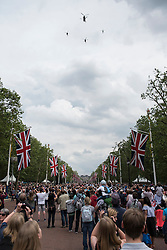 © Licensed to London News Pictures. 11/06/2016. London, UK. The Red Arrows and a fleet of other aircraft perform a flypast down The Mall and over Buckingham Palace during Trooping of the Colour on The Queen's 90th birthday.  Photo credit : Stephen Chung/LNP