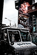 Ice cream vendor parks in front of large movie poster at Chinatown, Toronto, Canada
