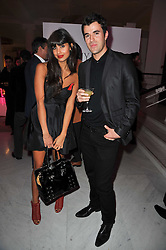 STEVE JONES and JAMEELA JAMIL at the launch of Project PEP to benefit the Elton John Aids Foundation hosted by Tamara Mellon and Diana Jenkins in association with Jimmy Choo held at Selfridges, Oxford Street, London on 29th October 2009.