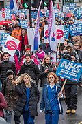 Nurses in scrubs at the front of the march - NHS In Crisis - Fix It Now March and Demonstration - organised by the Peoples Assembly started in Gower Street and finished outside Downing street.