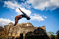Ratha, a performer at the Phare Circus in Siem Reap, Cambodia, does a back flip for a promotional video outside the Angkor Wat temple complex.