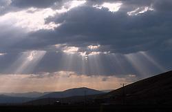 TURKEY DOGUBEYAZIT JUL02 - Sunset through rainclouds in the hills near Dogubayazit...jre/Photo by Jiri Rezac..© Jiri Rezac 2002..Contact: +44 (0) 7050 110 417.Mobile:  +44 (0) 7801 337 683.Office:  +44 (0) 20 8968 9635..Email:   jiri@jirirezac.com.Web:     www.jirirezac.com