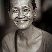 An attractive Chinese woman poses for the camera in a temple in Penang.