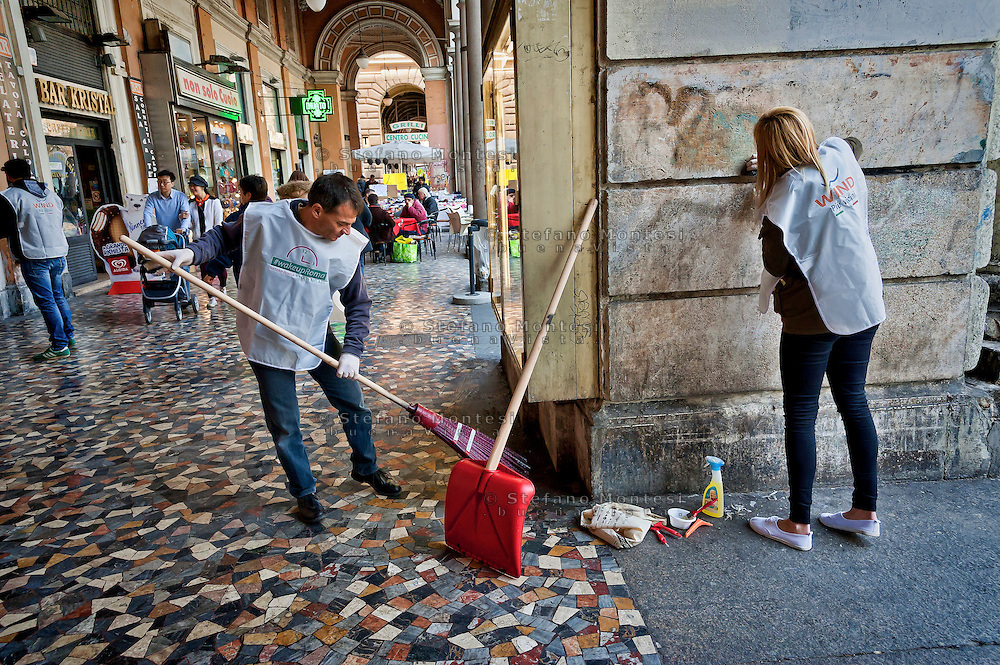 """The candidate for mayor, Stefano Fassina  cleans Piazza Vittorio together with volunteers.<br /> """"Wake up Roma ', the great collective mobilization promoted by Retake and Luiss EnLabs for the decorum of the city against the deterioration and abandonment. About three thousand volunteers with scrapers and brushes in hand they removed posters and stickers, clean walls and poles, they cleaned up gardens and flower beds, driveways and sidewalks. Interventions to Piazza Vittorio, Porta Maggiore, Villa Paganini and place Anco Marzio in Ostia. Rome, Italy 12th March 2016"""