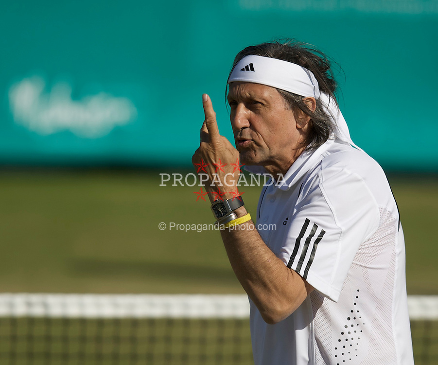 LIVERPOOL, ENGLAND - Thursday, June 12, 2008: Ilie Nastase (ROU) in action during the Legends' Doubles on Day Three of the Tradition-ICAP Liverpool International Tennis Tournament at Calderstones Park. (Photo by David Rawcliffe/Propaganda)