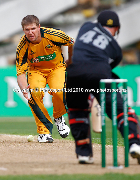 Australian bowler Ryan Harris fields off his own bowling. 4th one day international. New Zealand Black Caps versus Australia one day Chappell Hadlee cricket series. Eden Park, Auckland, New Zealand. Thursday 11 March 2010. Photo: Simon Watts/PHOTOSPORT