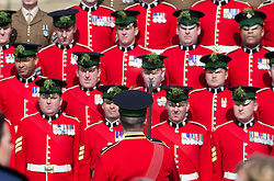 LONDON - UK - 17th Mar -2016: Preparations are made for the group photograph for the visit by HRH The Duke of Cambridge, Royal Colonel of the 1st Battalion Irish Guards  who attends the annual St Patrick's Day Parade at the barracks in West London. Prince William takes the salute and presents Shamrocks to serving soldiers. After the parade Prince William posed for the regimental photograph.<br /> <br /> Photograph by Ian Jones