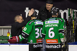 23.01.2015, Hala Tivoli, Ljubljana, SLO, EBEL, HDD Telemach Olimpija Ljubljana vs HC Znojmo Orli, 42. Runde, in picture Fabian Dahlem, head coach of HDD Telemach Olimpija, congrats Sebastijan Hadzic (HDD Telemach Olimpija, #30) for his first goal in EBEL league during the Erste Bank Icehockey League 42. Round between HDD Telemach Olimpija Ljubljana and HC Znojmo Orli at the Hala Tivoli, Ljubljana, Slovenia on 2015/01/23. Photo by Morgan Kristan / Sportida
