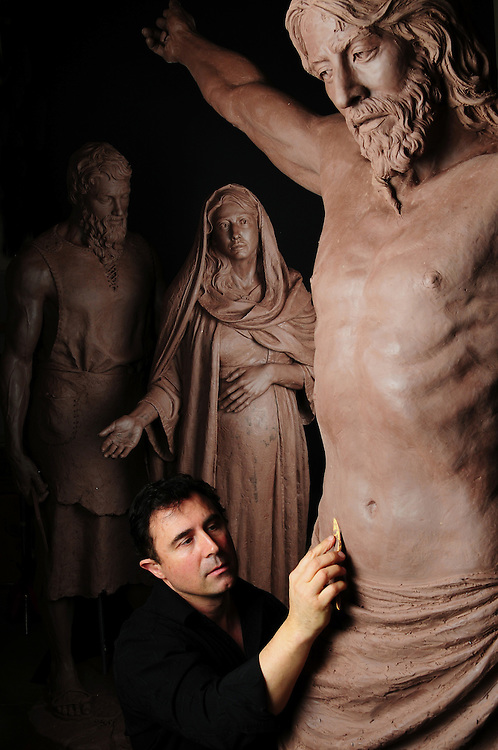 "Sculptor Rip Caswell works on ""the Crucifix""  with  ""Mary & Joseph"" in his studio. Mount Angel Abby, Benedict, Oregon."