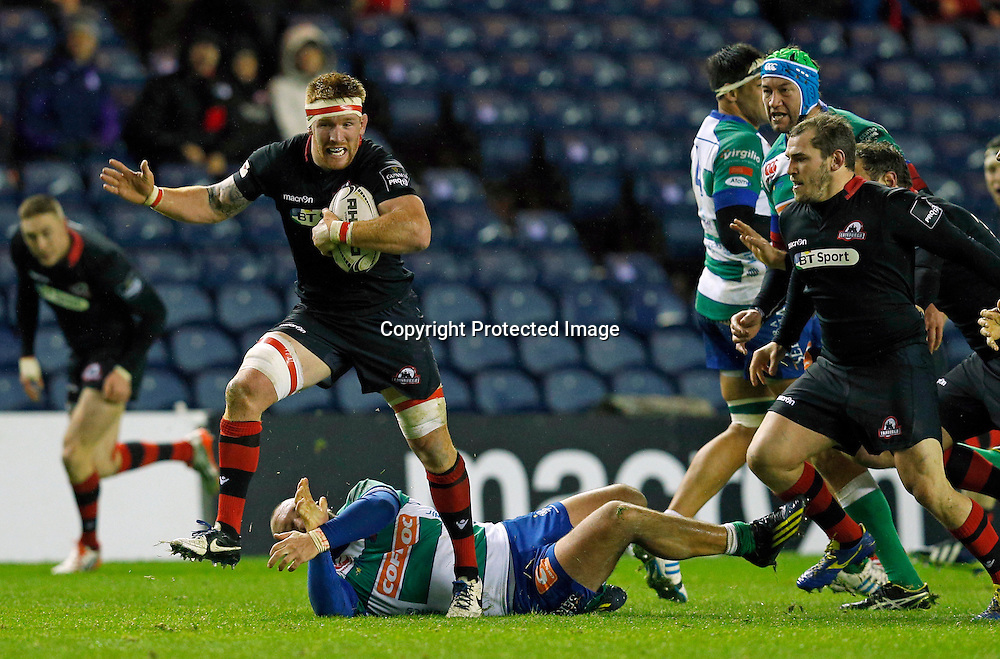 Guinness PRO12, BT Murrayfield, Scotland 19/12/2014<br /> Edinburgh vs Benetton Treviso <br /> Edinburgh's Roddy Grant escapes the tackle of Benetton Treviso&rsquo;s Alberto Lucchese<br /> Mandatory Credit &copy;INPHO/Russell Cheyne