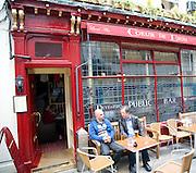 Men sitting outside Coeur de Lion pub, Bath