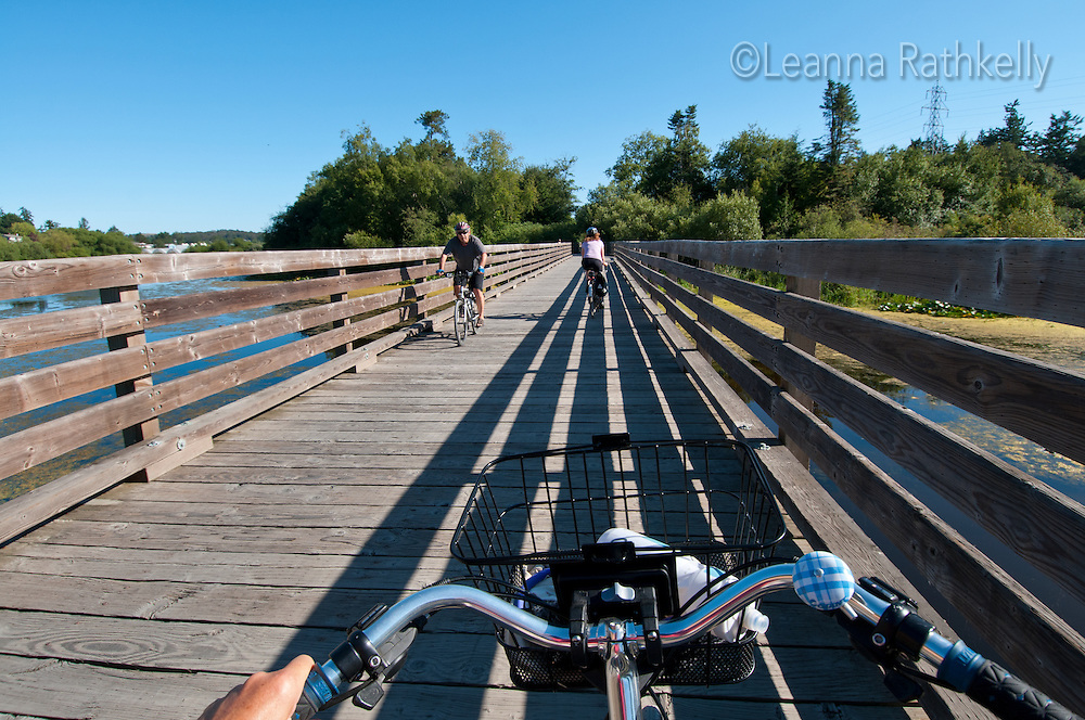 Cyclists ride the Blenkinsop Trestle bridge as part of a workday commute to downtown Victoria, BC
