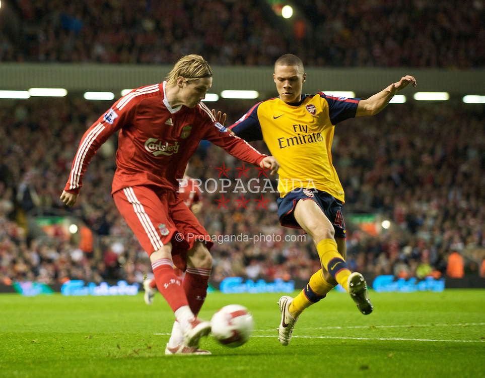 LIVERPOOL, ENGLAND - Tuesday, April 21, 2009: Liverpool's Fernando Torres and Arsenal's Kieran Gibbs during the Premiership match at Anfield. (Photo by David Rawcliffe/Propaganda)