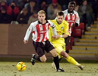 Photo: Leigh Quinnell.<br /> Cheltenham Town v Colchester United. LDV Vans Trophy.<br /> 24/01/2006. Cheltenhams captain John Finnigan is chased by Colchesters John White.