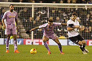 Reading FC midfielder Danny Williams and Derby County forward Chris Martin challenge for the ball during the Sky Bet Championship match between Derby County and Reading at the iPro Stadium, Derby, England on 12 January 2016. Photo by Aaron Lupton.