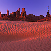 Distinctive Totem and Yai Bei Chai  in Monument Valley Tribal Park on the Navajo Reservation, AZ.