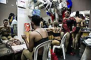 Dragqueens apply make up and dress for a perfomance in a gay bar in a busy touristic street of Kuta, Bali, Indonesia.
