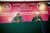 Tiger Woods of USA, left and Rory McIlroy of Northern Ireland speak during a press conference after completion of the Duel at Jinsha Lake at the Golf Villa Jinsha Lake on October 29, 2012 in Zhengzhou, China. McIlroy beat Woods by a single stroke shooting a 67 to Wood's 68.  Photograph by David Paul Morris