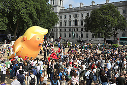© Licensed to London News Pictures. 13/07/2018. London, UK. A giant inflatable balloon depicting President Trump is flown over Parliament Square.  President Trump is on the second day of a four day visit to the UK. Photo credit: Peter Macdiarmid/LNP