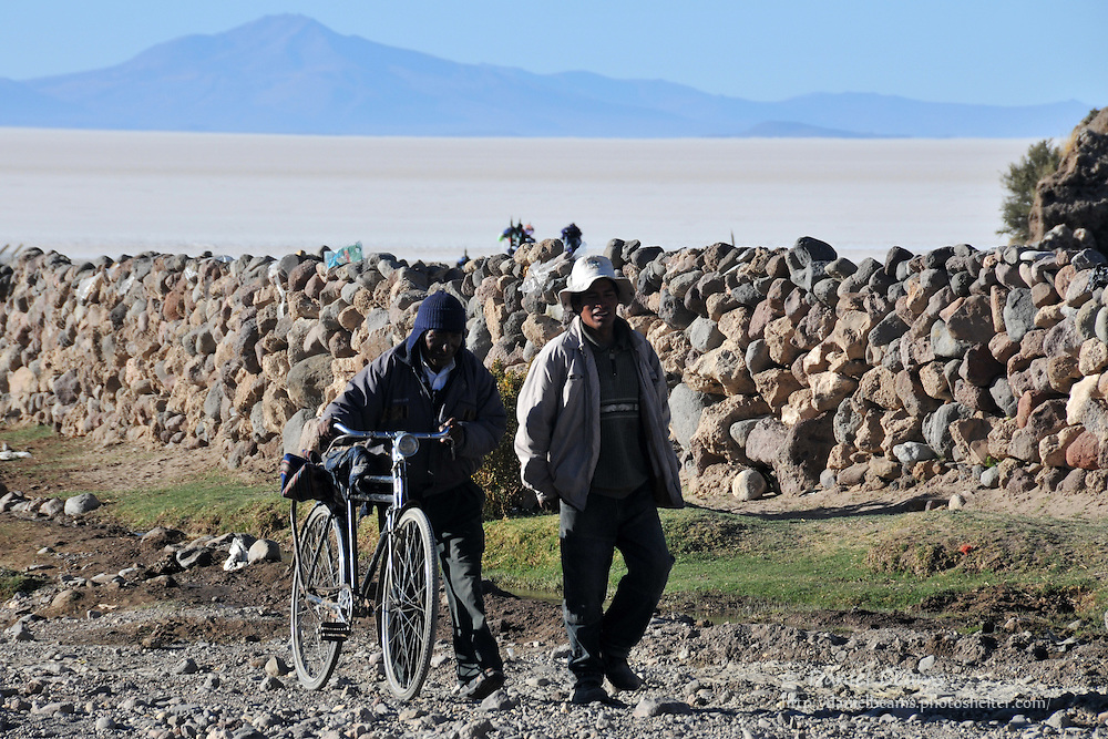 Two men and an bicycle in Tahua, Bolivia on the Salar de Uyuni