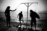 Tourists rinse after an early-morning dip in Israel's Dead Sea, where the reputed healing benefits of sun, salt water, black mud and barometric pressure have attracted visitors for thousands of years.