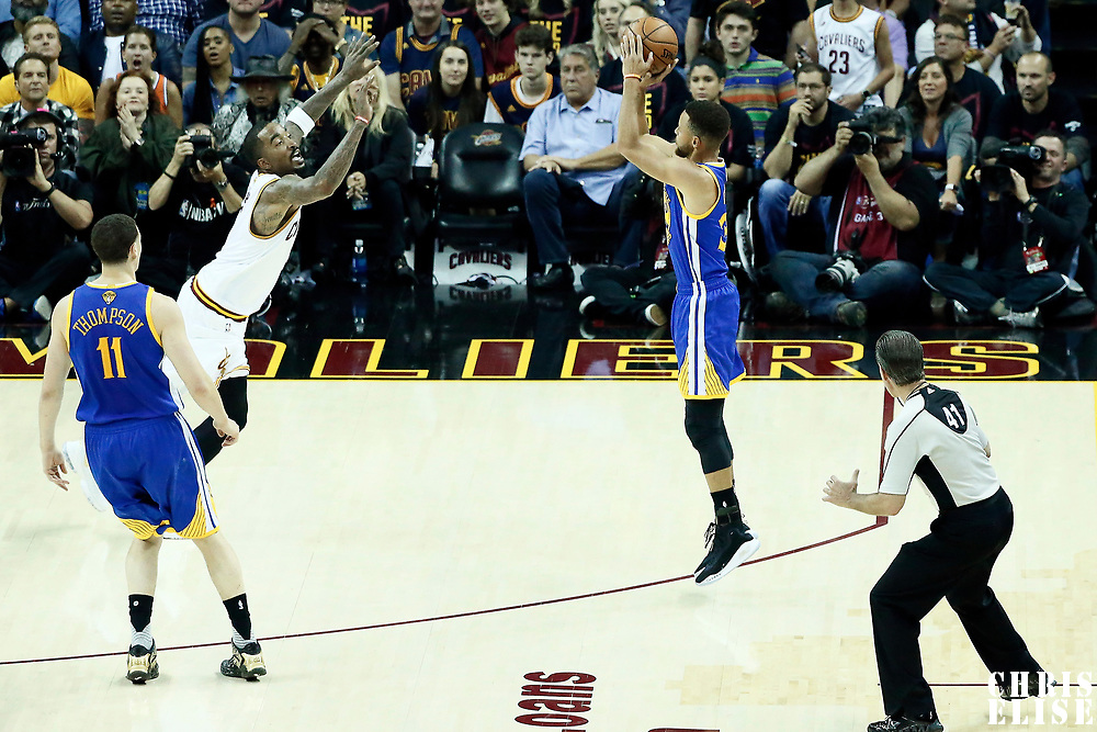 07 June 2017: Golden State Warriors guard Stephen Curry (30) takes a jump shot over Cleveland Cavaliers guard JR Smith (5) during the Golden State Warriors 118-113 victory over the Cleveland Cavaliers, in game 3 of the 2017 NBA Finals, at  the Quicken Loans Arena, Cleveland, Ohio, USA.