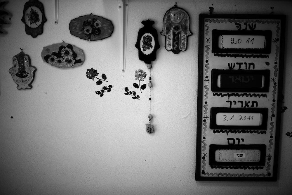 Lucky khamsas, made by holocaust survivors, are hung on a wall next to a calendar in the Shaar Menashe Mental Health Center for Holocaust survivors in Pardes Hanna, Israel on Jan 3, 2011.