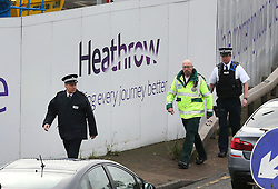 © Licensed to London News Pictures. 26/11/2015. London, UK. Police and an ambulance worker at the entrance to the tunnel. . A group of Airport expansion activists cause traffic chaos by blocking off the inbound tunnel of Heathrow airport in London to protest against airport expansion.  Photo credit: Peter Macdiarmid/LNP