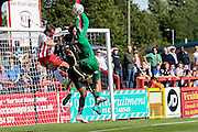 York City goalkeeper Scott Flinders catches the ball in front of Stevenage Midfielder Charlie Lee  during the Sky Bet League 2 match between Stevenage and York City at the Lamex Stadium, Stevenage, England on 12 September 2015. Photo by Simon Davies.