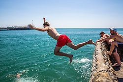 © Licensed to London News Pictures. 30/06/2016. Brighton, UK. Members of the public cool off in the sea by as thousands of visitors take to the beach in Brighton and Hove as sunny and hot weather is hitting the seaside resort. Photo credit: Hugo Michiels/LNP