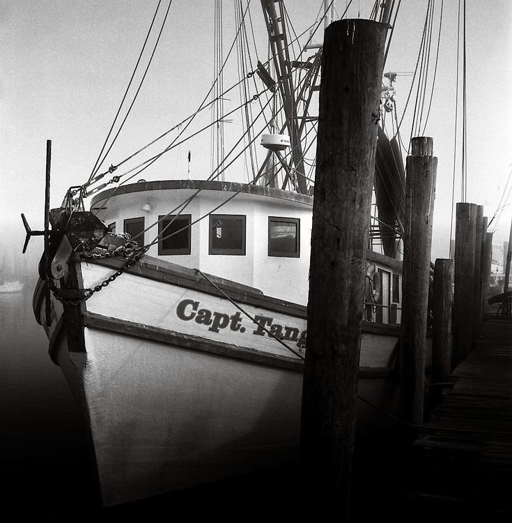The shrimp trawler, the Captain Tang lays docked on Shem Creek