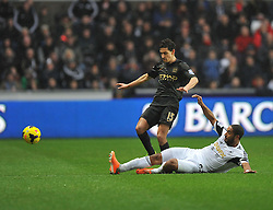Swansea City's Ashley Williams tackles Manchester City's Jesús Navas - Photo mandatory by-line: Alex James/JMP - Tel: Mobile: 07966 386802 01/01/2014 - SPORT - FOOTBALL - Liberty Stadium - Swansea - Swansea City v Manchester City - Barclays Premier League