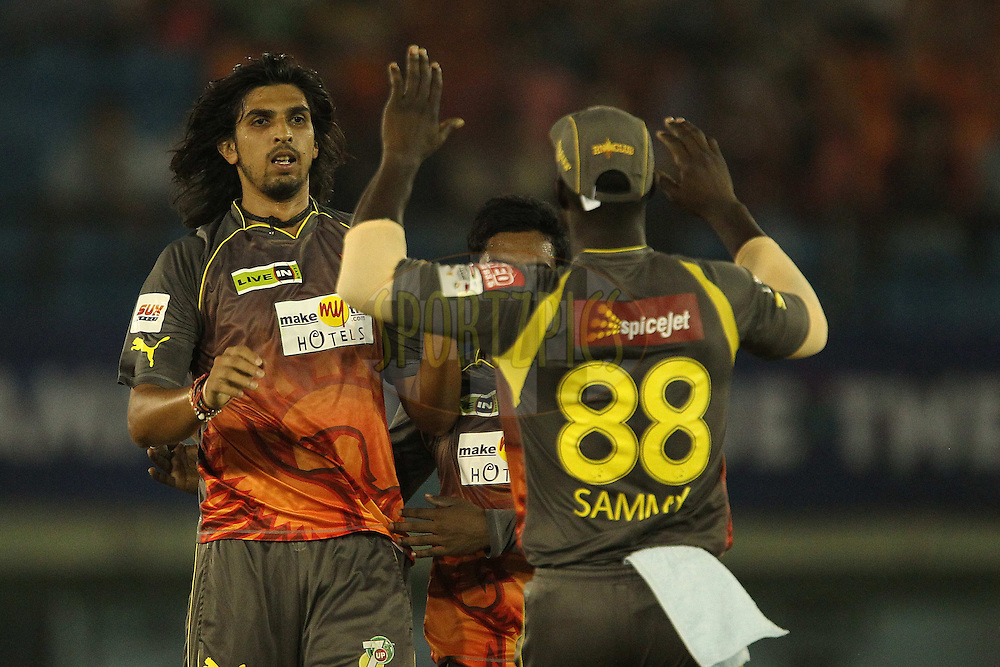 Ishant Sharma celebrates the wicket of Upul Tharanga of Kandurata Maroons  during the Qualifier 2 match of the Karbonn Smart Champions League T20 (CLT20) between Sunrisers Hyderabad and the Kandurata Maroons held held at the Punjab Cricket Association Stadium, Mohali on the 17th September 2013<br /> <br /> Photo by Ron Gaunt/CLT20/SPORTZPICS<br /> <br /> <br /> Use of this image is subject to the terms and conditions as outlined by the CLT20. These terms can be found by following this link:<br /> <br /> http://sportzpics.photoshelter.com/image/I0000NmDchxxGVv4<br /> <br /> ENTER YOUR EMAIL ADDRESS TO DOWNLOAD